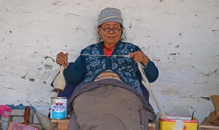 Old Tibetan woman making yarn. Photo: Sudeep Singh