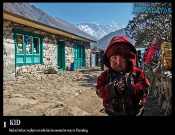 Kid at Debuche plays outside his home on the way to Phakding everest region