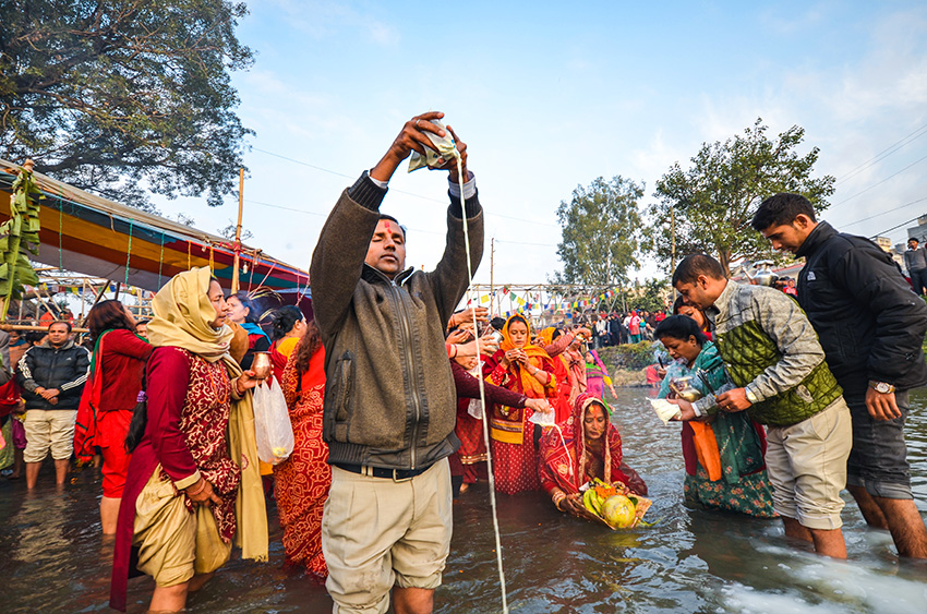Devotees offering prayers to the Sun on Chhat Festival.