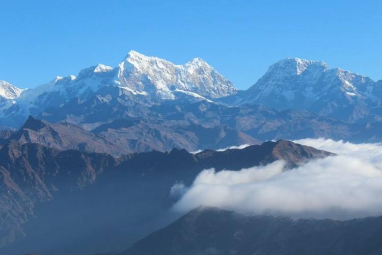 Biking Up a Snowy Mountain in Nepal