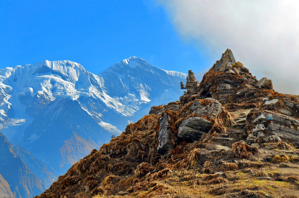 Mountain Landscape in Himalaya. Piramid of stones. Annapurna South peak, Nepal, Mardi Himal track.