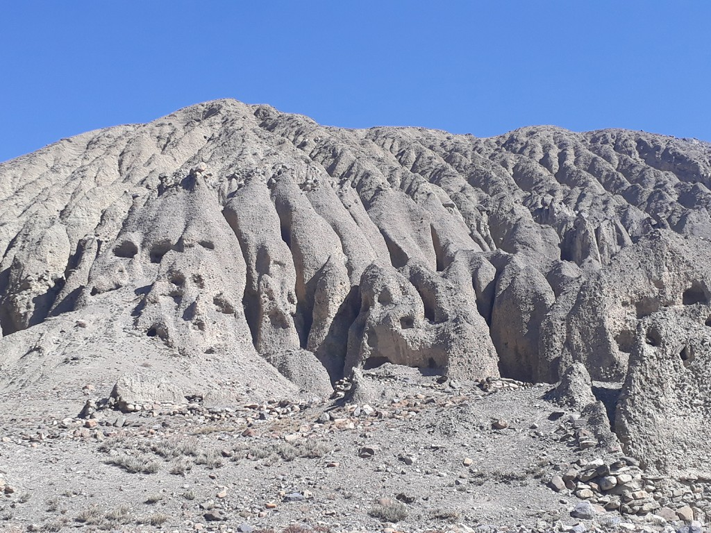 Meditation caves have been carved into the anthill-like geology of Lower Mustang. Photo Elen Turner