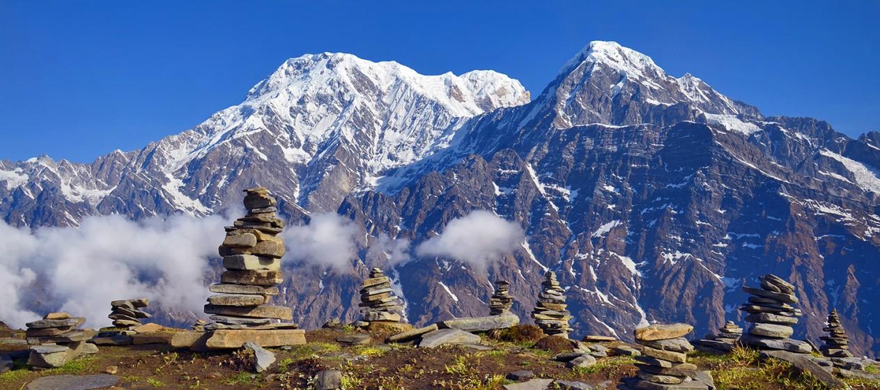Mountain Landscape in Himalaya. Piramid of stones. Annapurna South peak, Hiun Chuli, Nepal, Mardi Himal track.