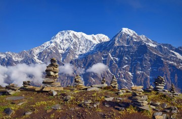 Mountain Landscape in Himalaya. Piramid of stones. Annapurna South peak, Hiun Chuli, Nepal, Mardi Himal track.