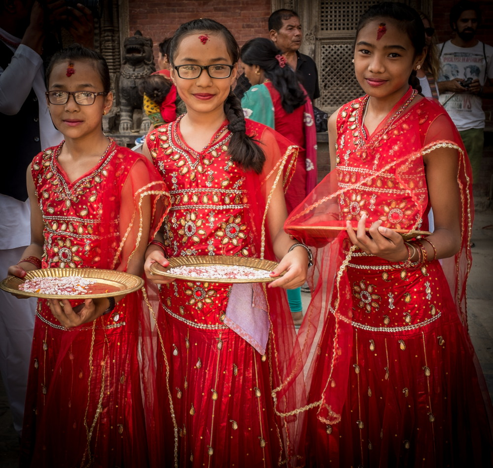 Girls in a street procession at Patan Durbar Square during the Dashain festival. Photo: Sue Hankins