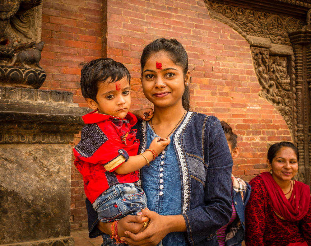 A girl and her little brother at Patan Durbar Square. Photo: Sue Hankins