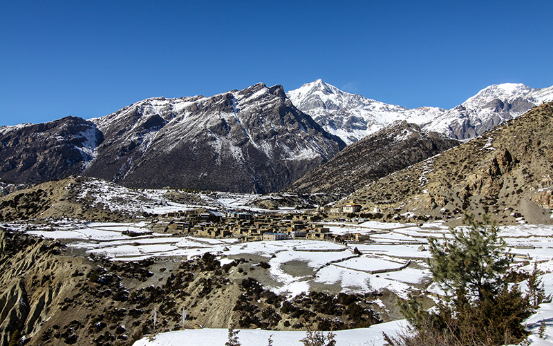 Villages blanketed in snow are especially picturesque. Photo: Tashi Sherpa
