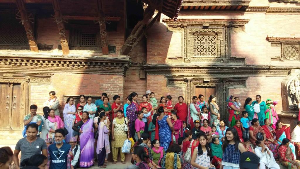 Waiting to see the chariot at Patan Durbar Square. Photo: Elen Turner