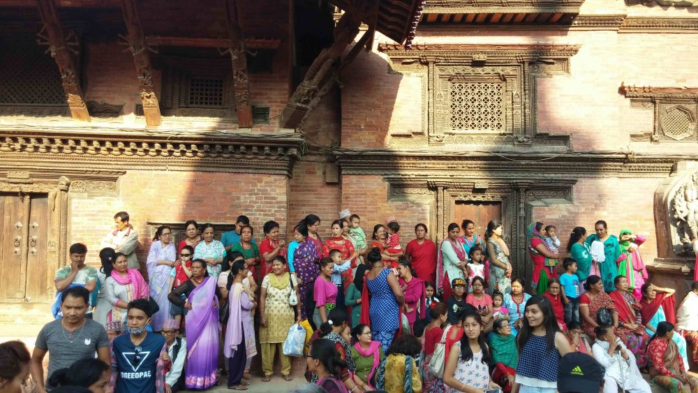 Waiting to see the chariot at Patan Durbar Square. Photo: Elen Turner