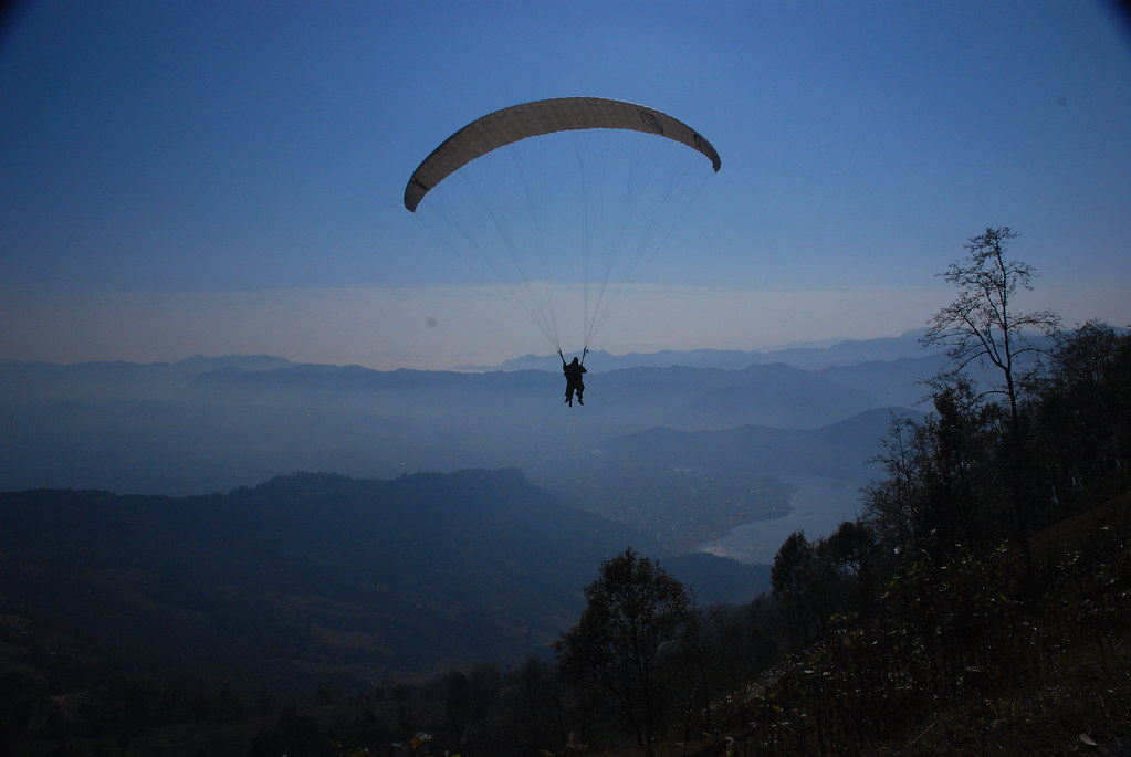 Paragliding above Pokhara. Photo: Vera & Jean-Christophe/Flickr